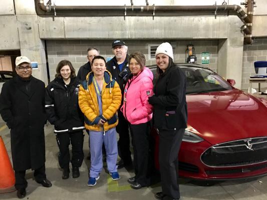 Research team (left to right) Abdul Wase M.D. (principal ivestigator), Marina Brown R.N., Ken Shneider, Thein Aung M.D., Matt Clark, Dawn Hunt and Kimberle Evans R.N., with a Tesla car at Good Samaritan Hospital Dayton, Ohio.  Image courtesy of Joe Carfora.