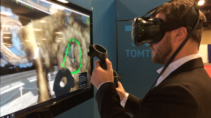 TomTec's work-in-progress virtual reality workstation to review echo exams in actual 3-D using video gaming technology. The operator is performing an valve area quantification measure during a demonstration on the expo floor of the American Society of Echocardiography (ASE) 2018 in June. #ASE #ASE2018 #ASE18 #echocardiography #tomtec